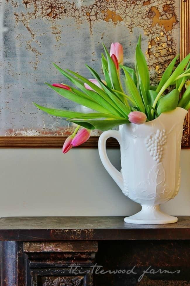 milk glass with flowers